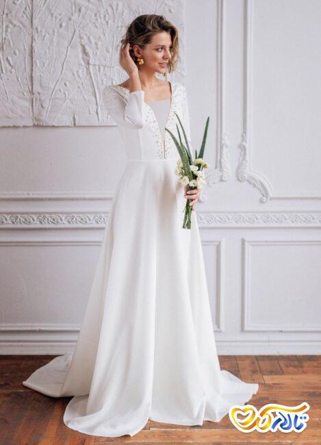 لباس عروسی مرواریددوزی شده