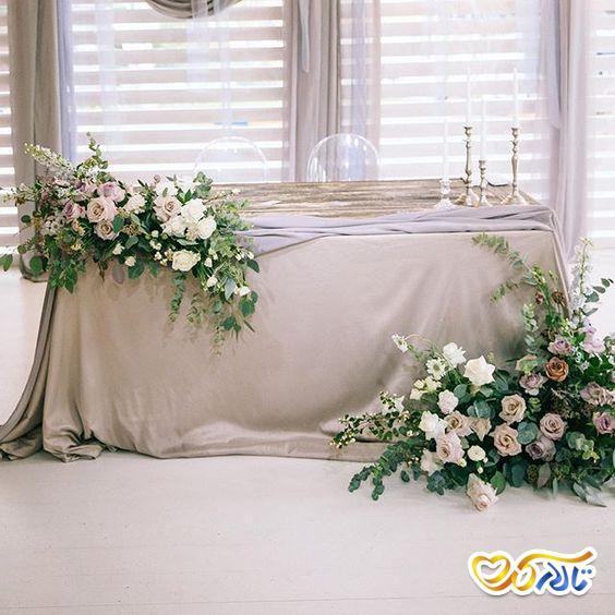 گل آرایی و دکوراسیون زیبا برای جایگاه عروس و داماد